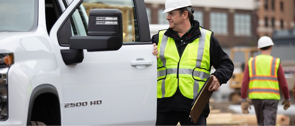 Fleet worker opening door to Chevy truck