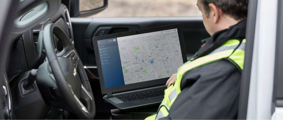 Man using OnStar Vehicle Insights in vehicle