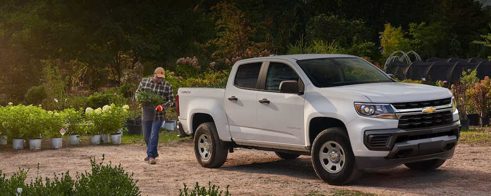 2021 Chevy Colorado owner unloading plants from the truck bed
